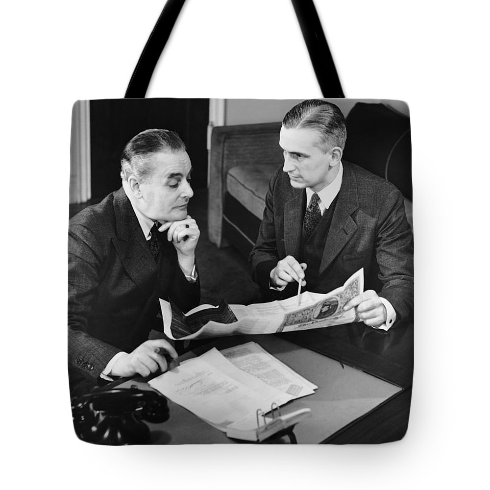 People Tote Bag featuring the photograph Businessmen Having A Meeting by George Marks