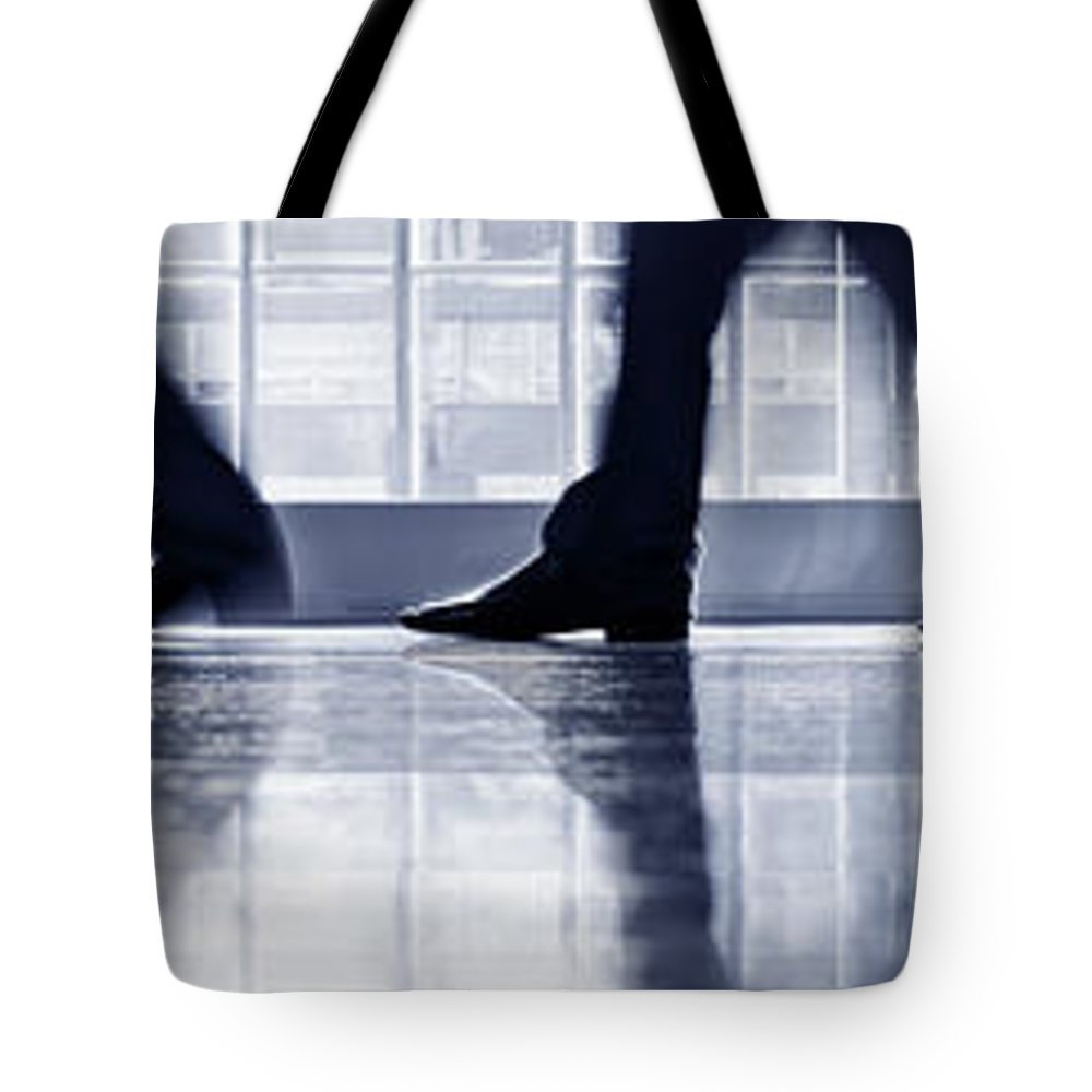 Corporate Business Tote Bag featuring the photograph Businesspeople Walking In Lobby, Low by Poba