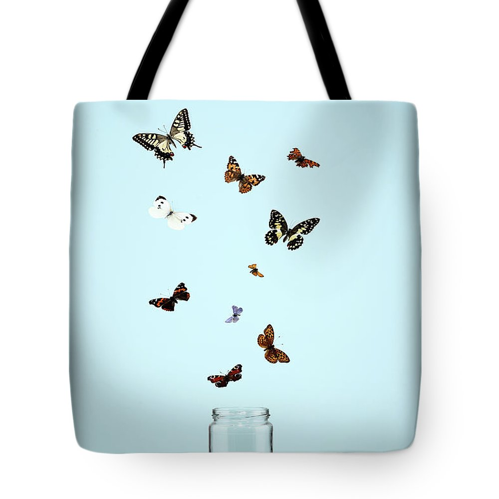 Animal Themes Tote Bag featuring the photograph Butterflies Escaping From Jar by Martin Poole