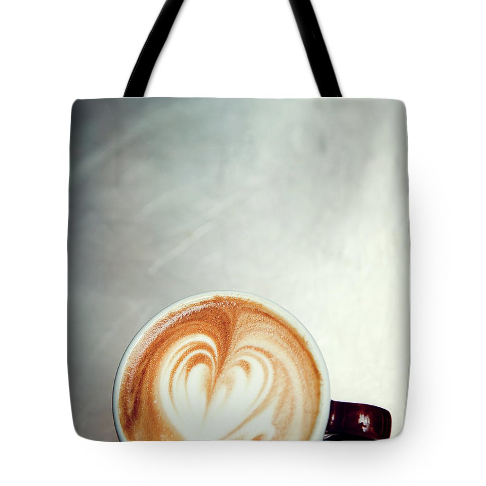 Spoon Tote Bag featuring the photograph Caffe Macchiato Heart Shape On Brushed by Ryanjlane
