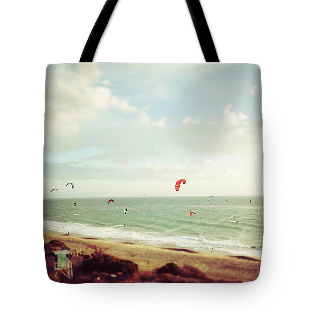 California Tote Bag featuring the photograph California Tilt Shifted Kite Surfers by Kevinruss
