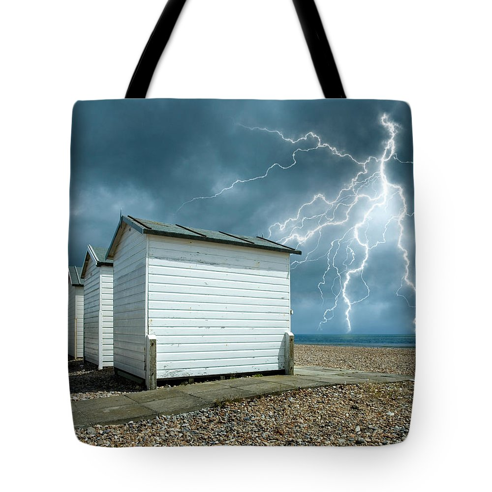 Water's Edge Tote Bag featuring the photograph Calm Before The Storm by Blackbeck