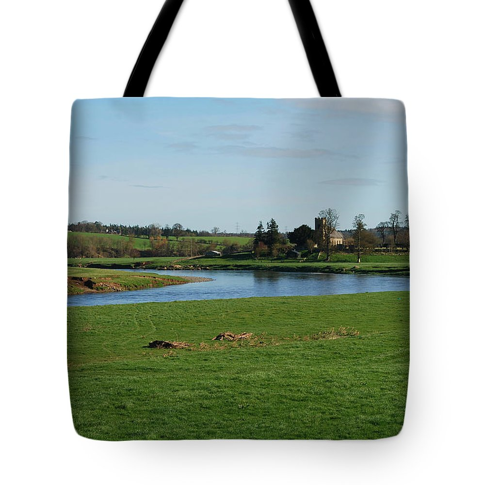 Carham Church Tote Bag featuring the photograph Carham Church And River Tweed by Victor Lord Denovan