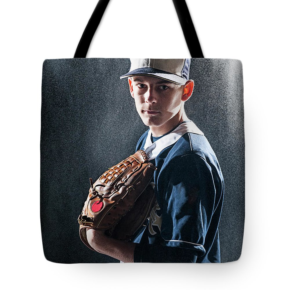 Baseball Cap Tote Bag featuring the photograph Caucasian Baseball Player Standing by Erik Isakson