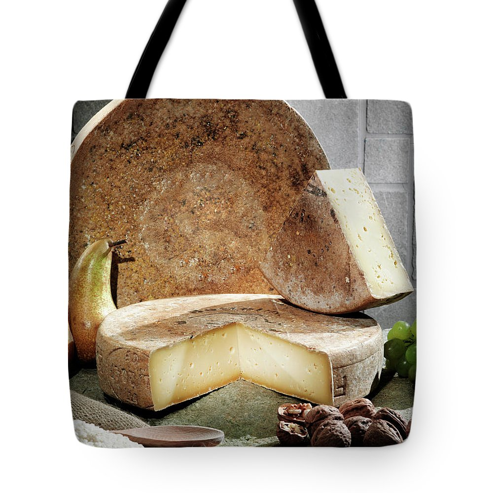 Fontina Tote Bag featuring the photograph Cheese, Fruit And Grains On Table by Walter Zerla