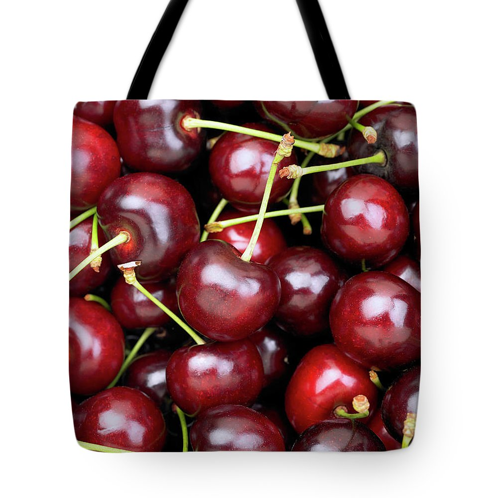 Cherry Tote Bag featuring the photograph Cherries by Maria Toutoudaki