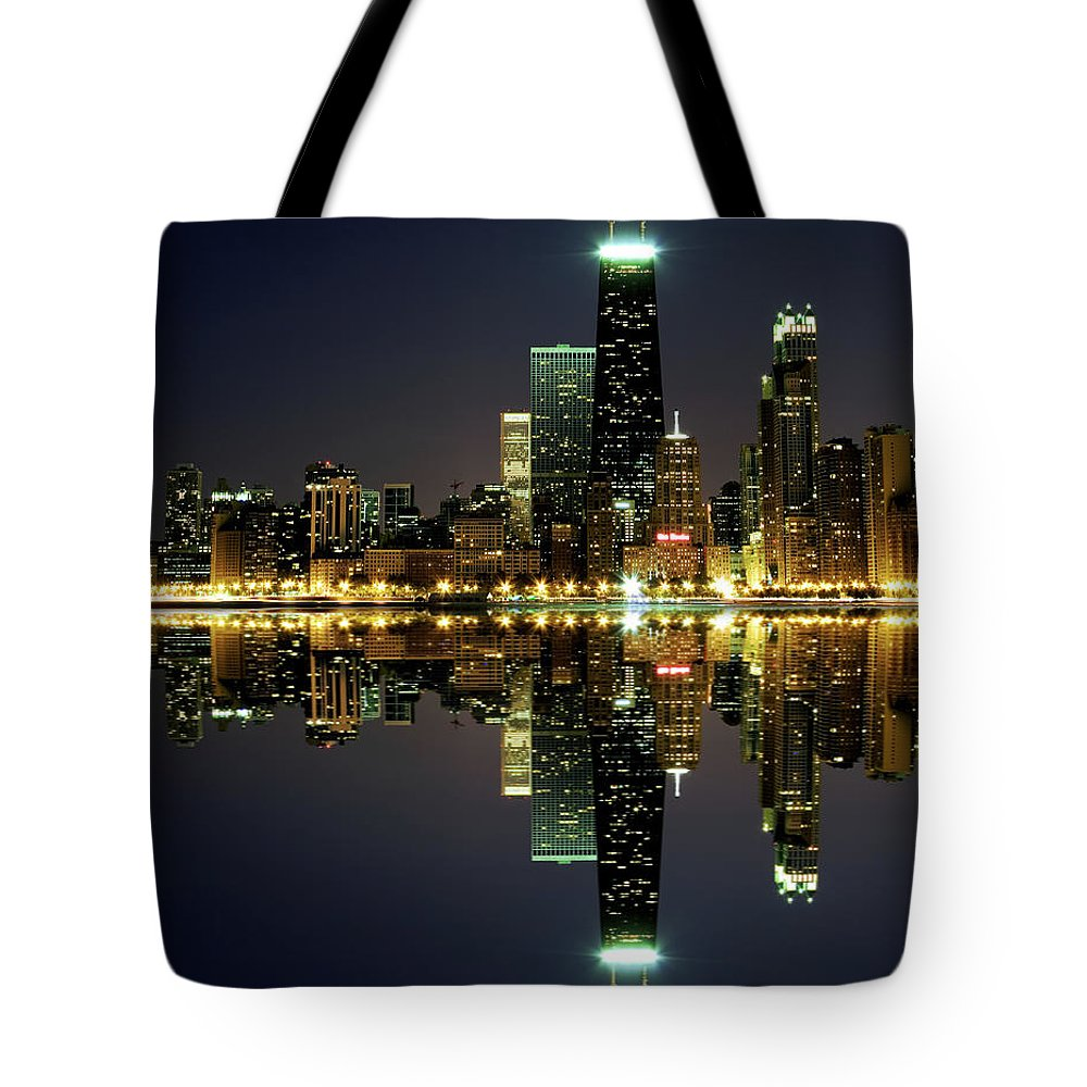 Lake Michigan Tote Bag featuring the photograph Chicago Skyline Reflected On Lake by Pawel.gaul