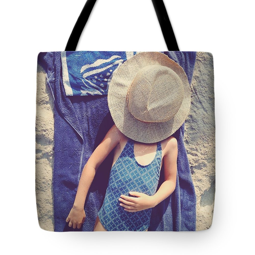 4-5 Years Tote Bag featuring the photograph Child In Swimsuit Laying On Towel With by Jodie Griggs