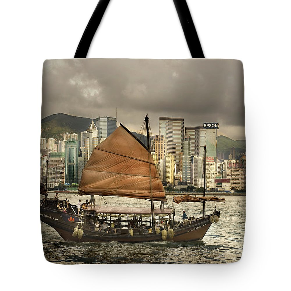 Sailboat Tote Bag featuring the photograph China, Hong Kong, Junk Boat In Bay by Maremagnum