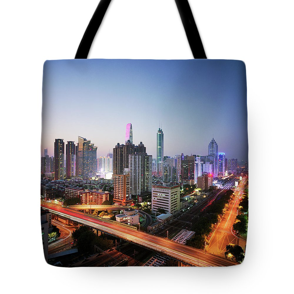 Corporate Business Tote Bag featuring the photograph China, Shenzen Skyline At Dusk by Martin Puddy