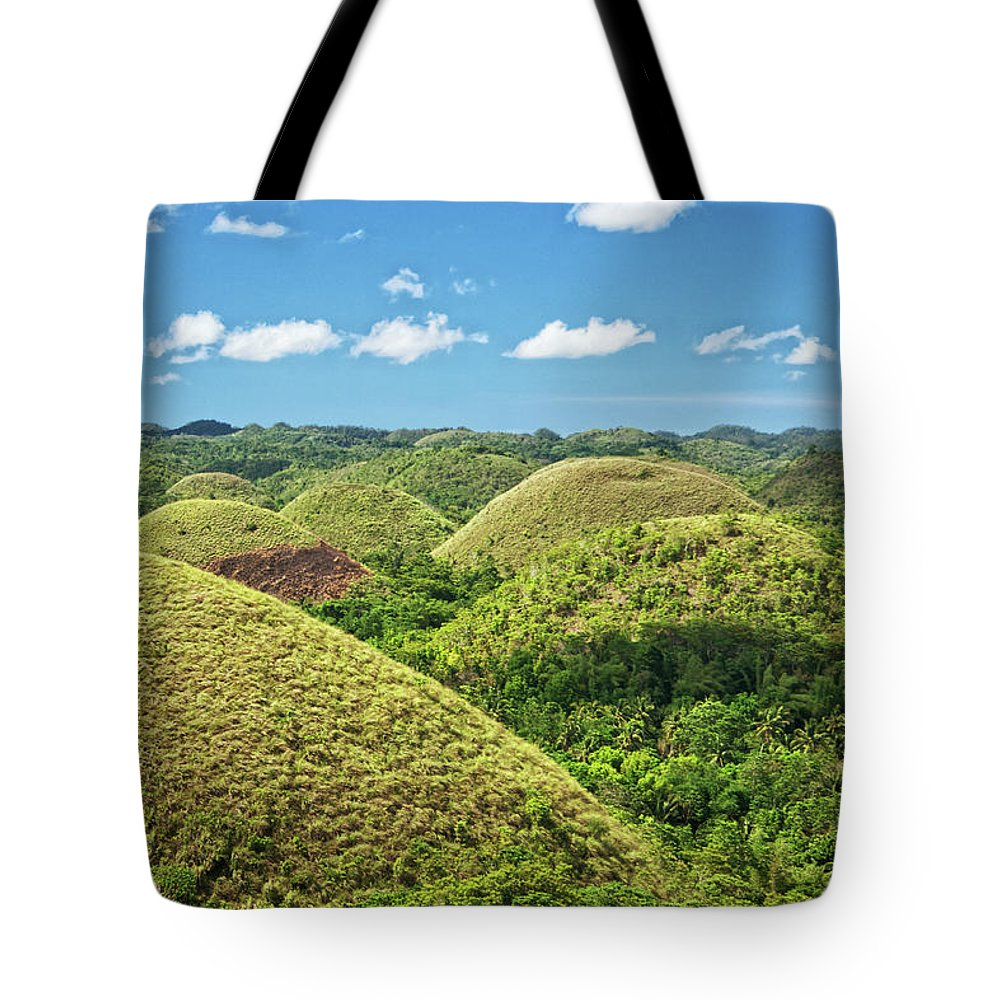 Scenics Tote Bag featuring the photograph Chocolate Hills In Bohol by Photography By Jeremy Villasis. Philippines.