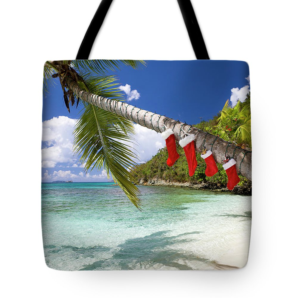 Scenics Tote Bag featuring the photograph Christmas Decorations On A Palm Tree At by Cdwheatley