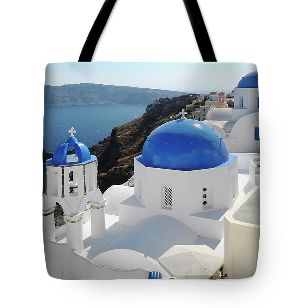 Greek Culture Tote Bag featuring the photograph Churches In Oia, Santorini, Greece by Tunart