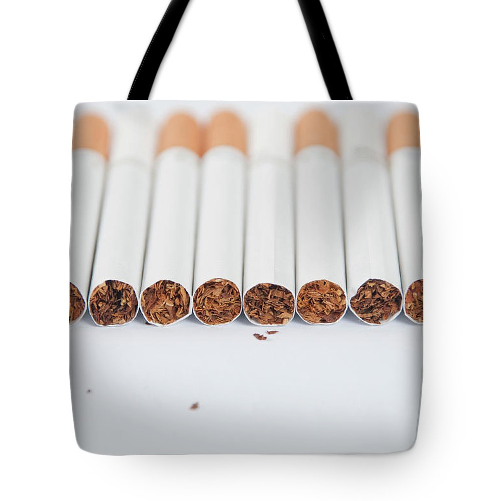White Background Tote Bag featuring the photograph Cigarette by Shui Ta Shan