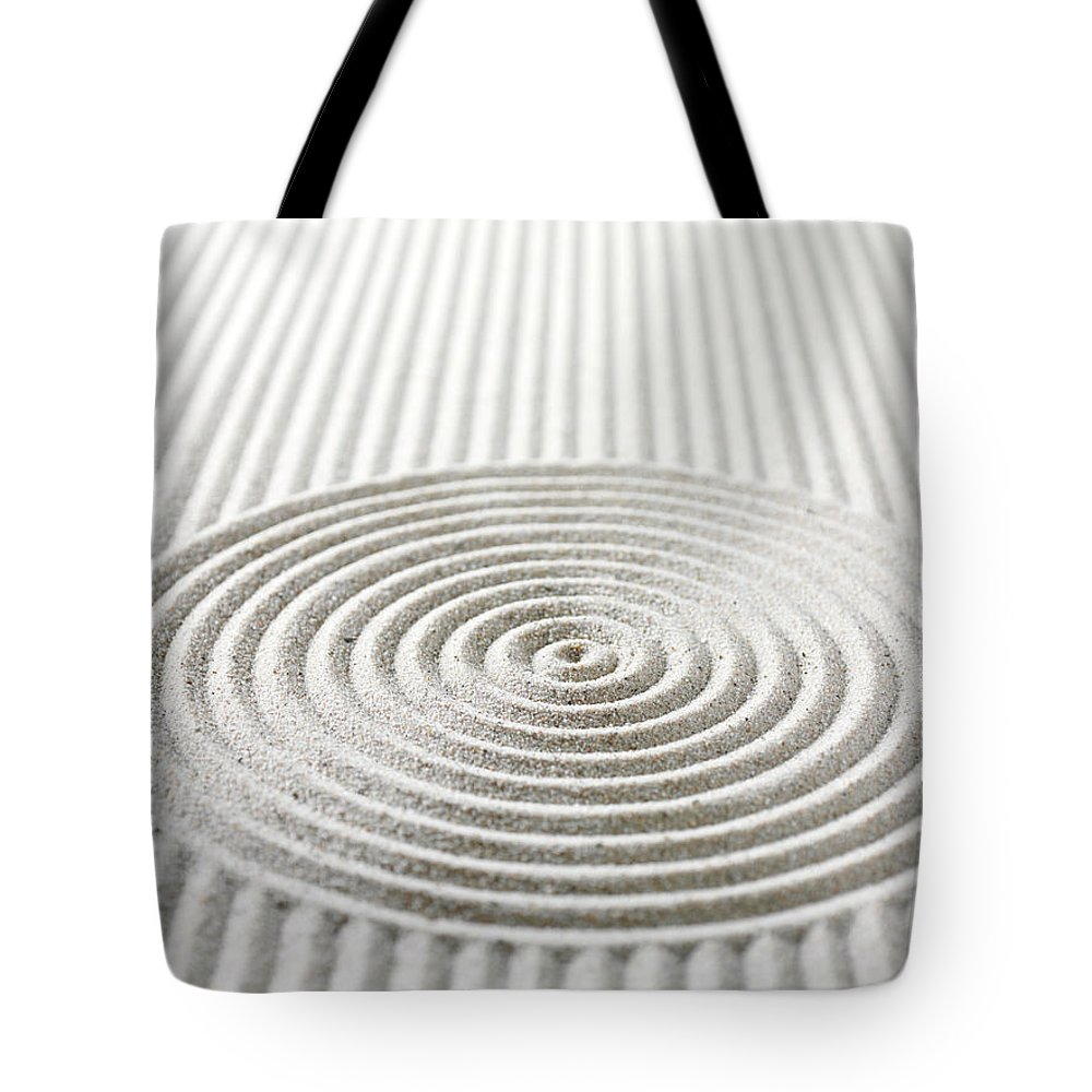 In A Row Tote Bag featuring the photograph Circles And Lines In Sand by Wragg