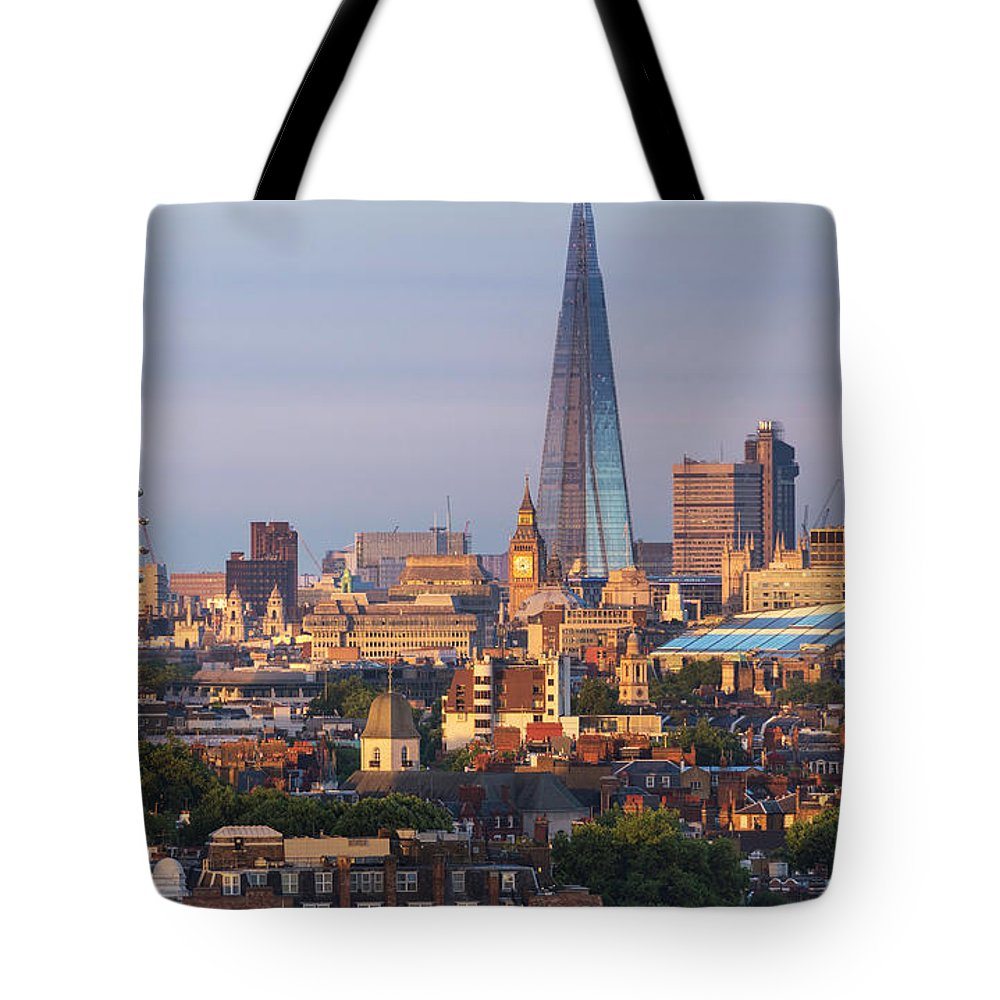 Tranquility Tote Bag featuring the photograph City Skyline In Late Evening Sunlight by Simon Butterworth