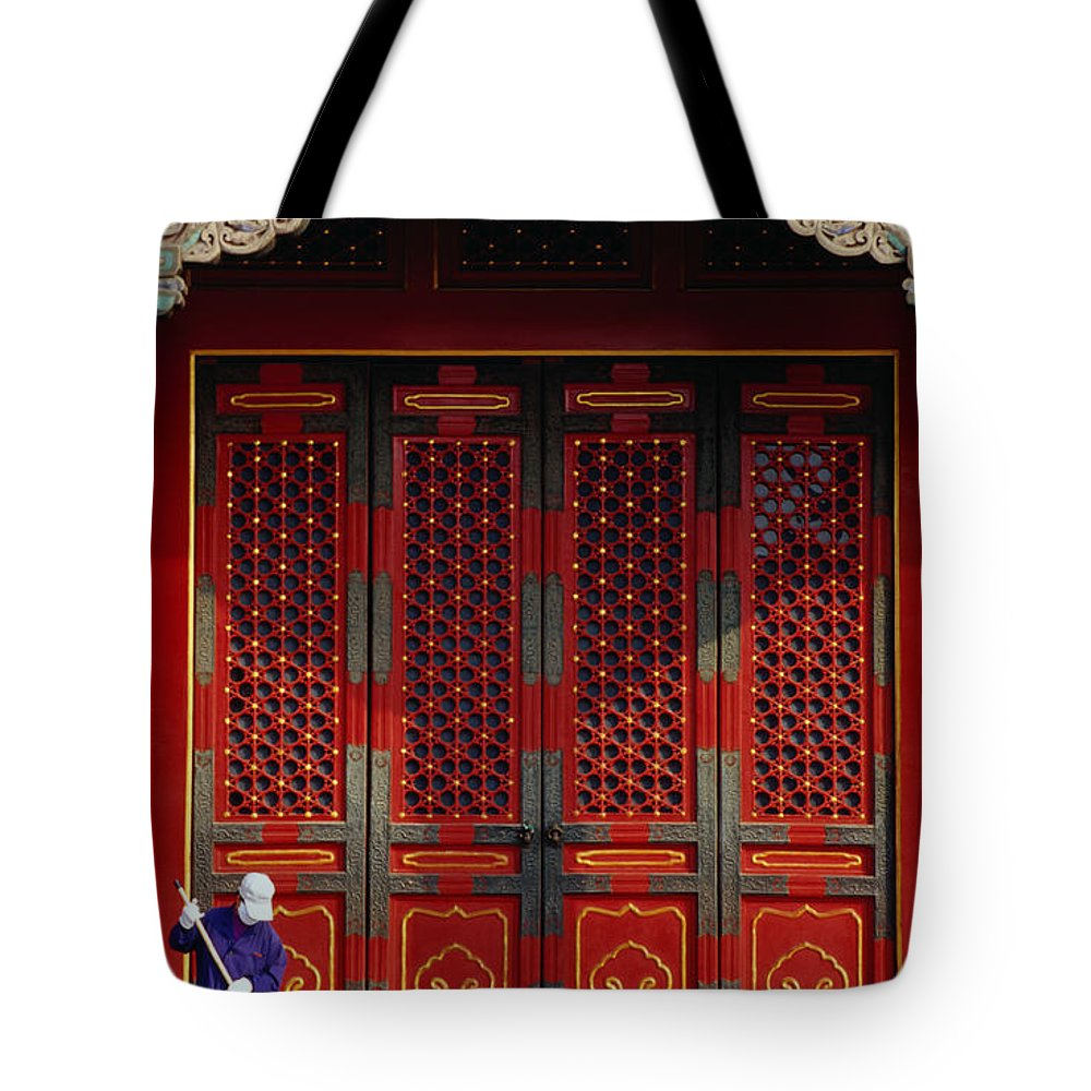 Working Tote Bag featuring the photograph Cleaner Sweeps Steps Inside The by Lonely Planet