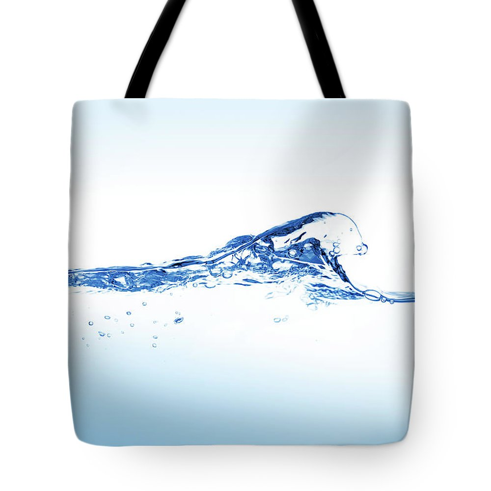 Purity Tote Bag featuring the photograph Clear Blue Water Splashing, Ripples And by Pixedeli