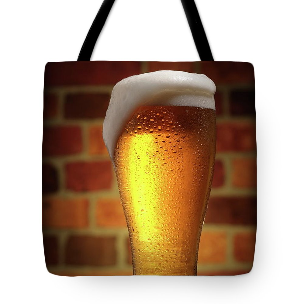 Orange Color Tote Bag featuring the photograph Clear Cold Bear With Foam Overflow by Eltoddo