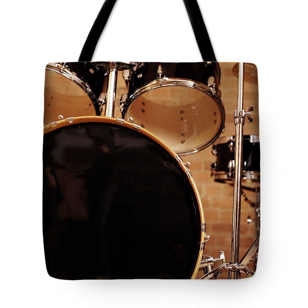 Microphone Stand Tote Bag featuring the photograph Close-up Of A Drum Kit by Digital Vision.