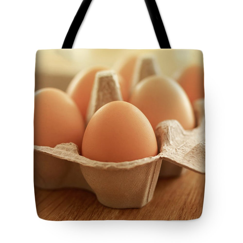 Free Range Tote Bag featuring the photograph Close Up Of Brown Eggs In Carton by Adam Gault