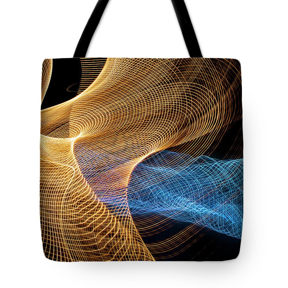 Internet Tote Bag featuring the photograph Close Up Of Flowing Light Trails by John M Lund Photography Inc