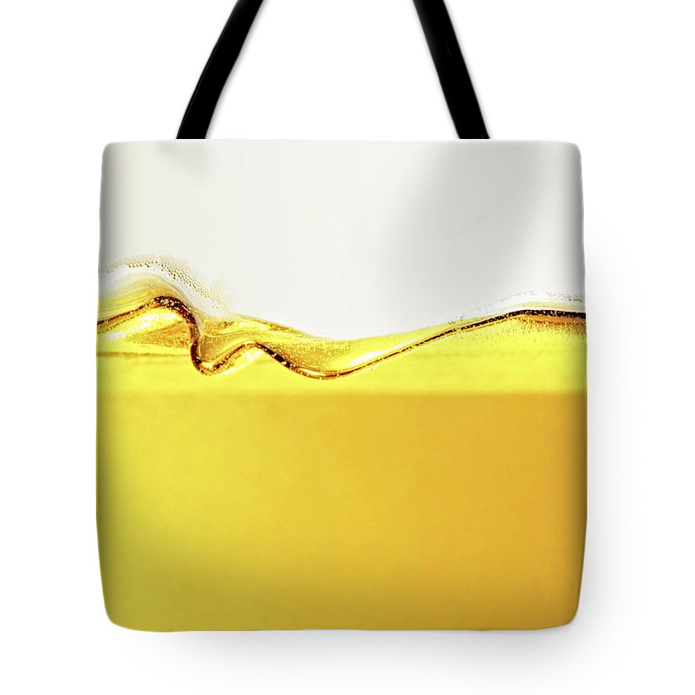 Motion Tote Bag featuring the photograph Close Up Of Oil In Glass by Cwp