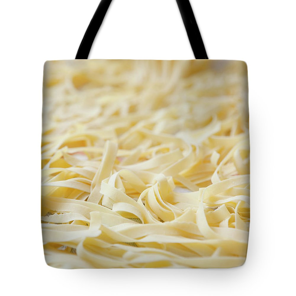 Sicily Tote Bag featuring the photograph Close Up Of Pasta Noodles by Judith Haeusler