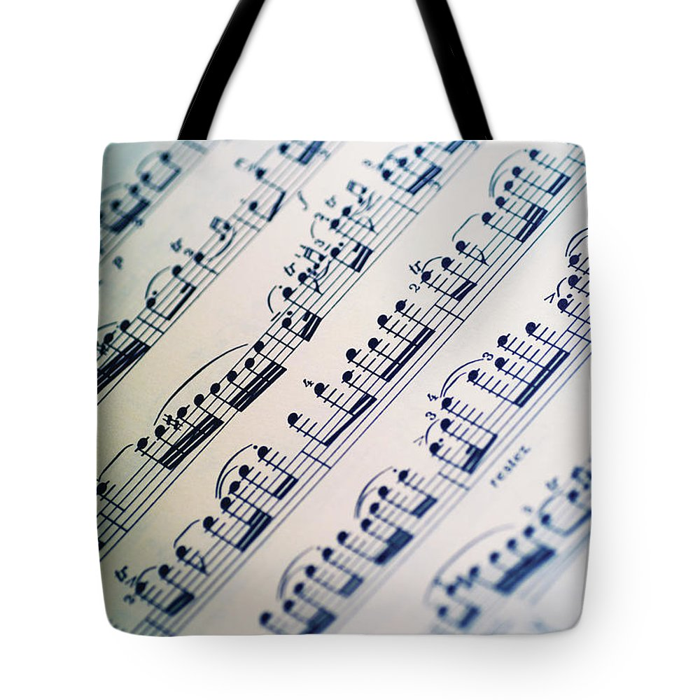 Sheet Music Tote Bag featuring the photograph Close-up Of Sheet Music by Medioimages/photodisc