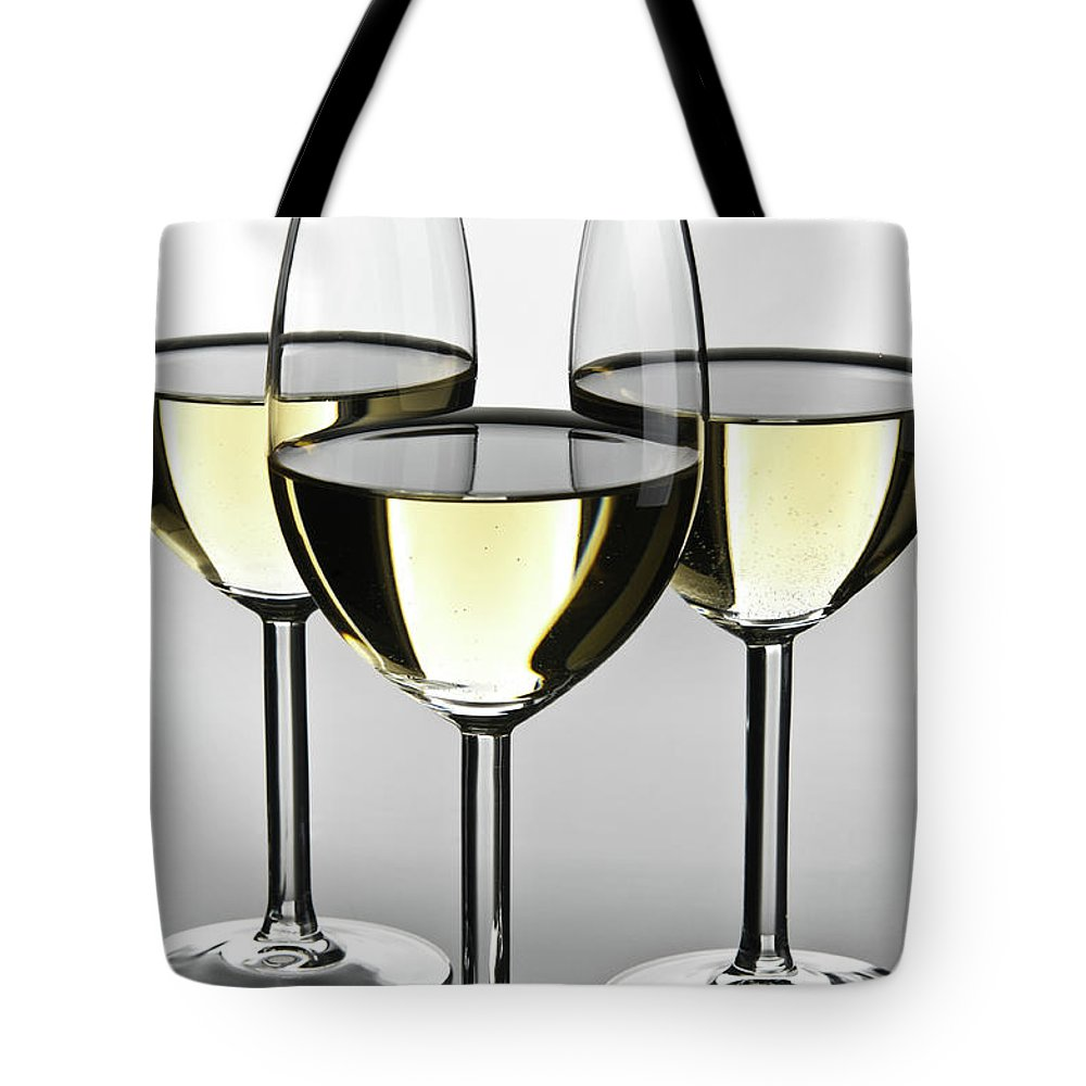 Alcohol Tote Bag featuring the photograph Close-up Of Three White Wine Glasses by Domin domin