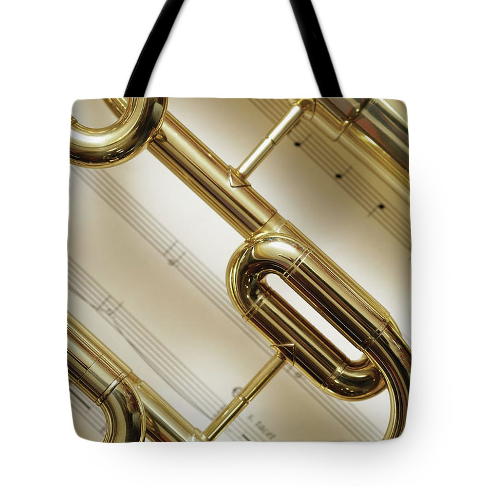 Sheet Music Tote Bag featuring the photograph Close-up Of Trumpet by Medioimages/photodisc