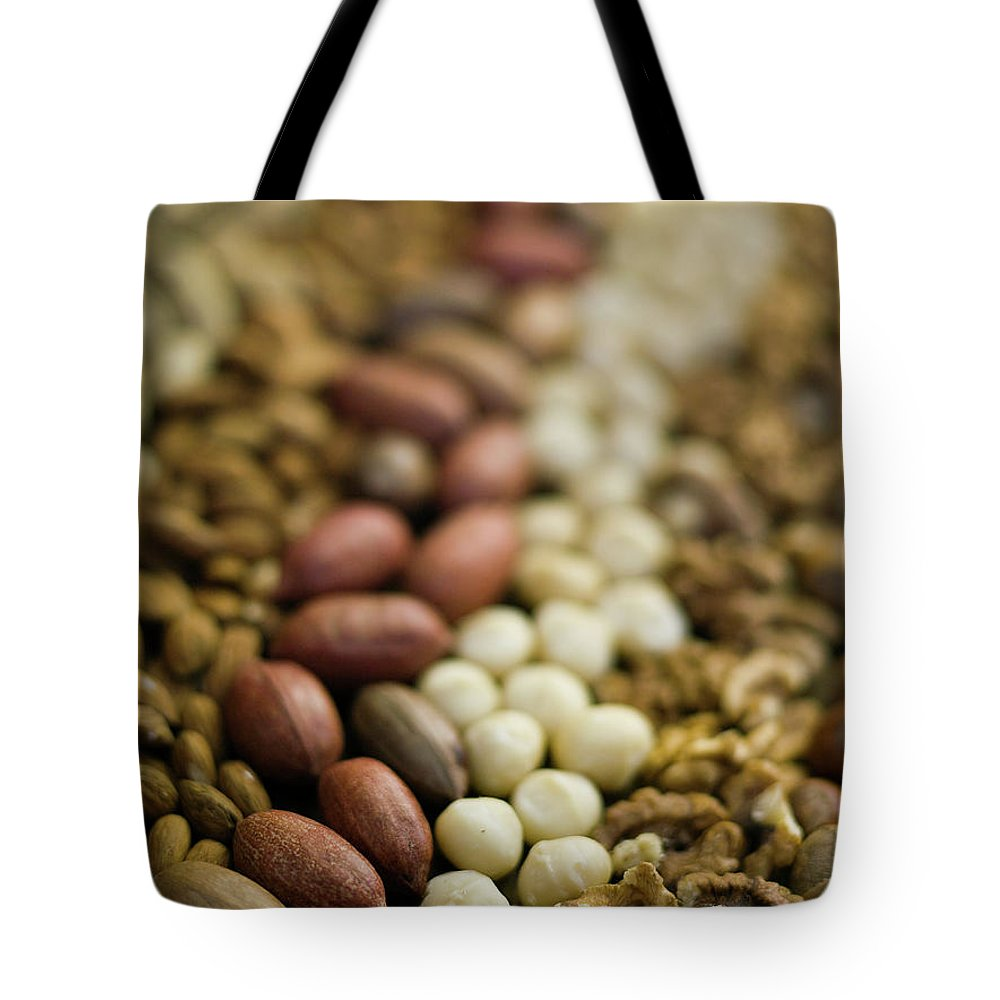 Nut Tote Bag featuring the photograph Close Up Of Variety Of Nuts by Johner Images