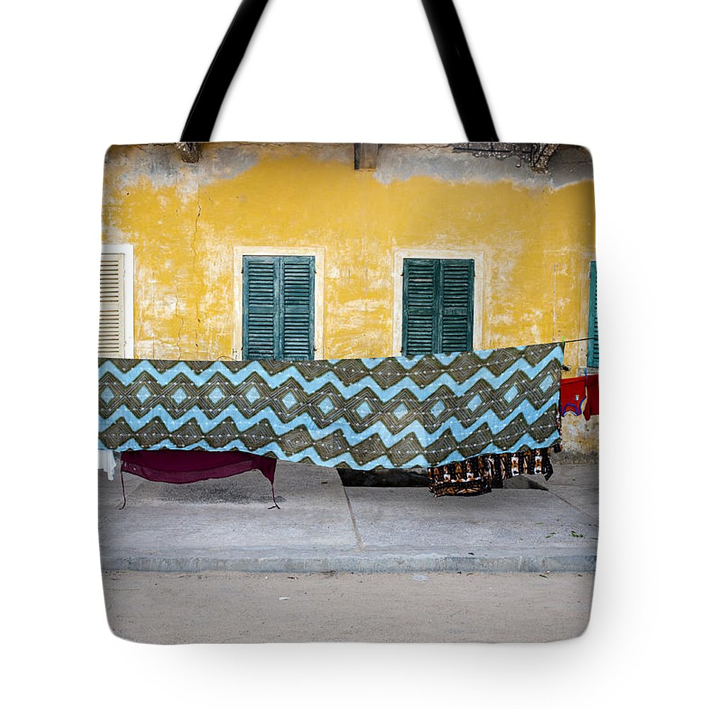 Hanging Tote Bag featuring the photograph Clothes Hanging by Roripalazzo.com