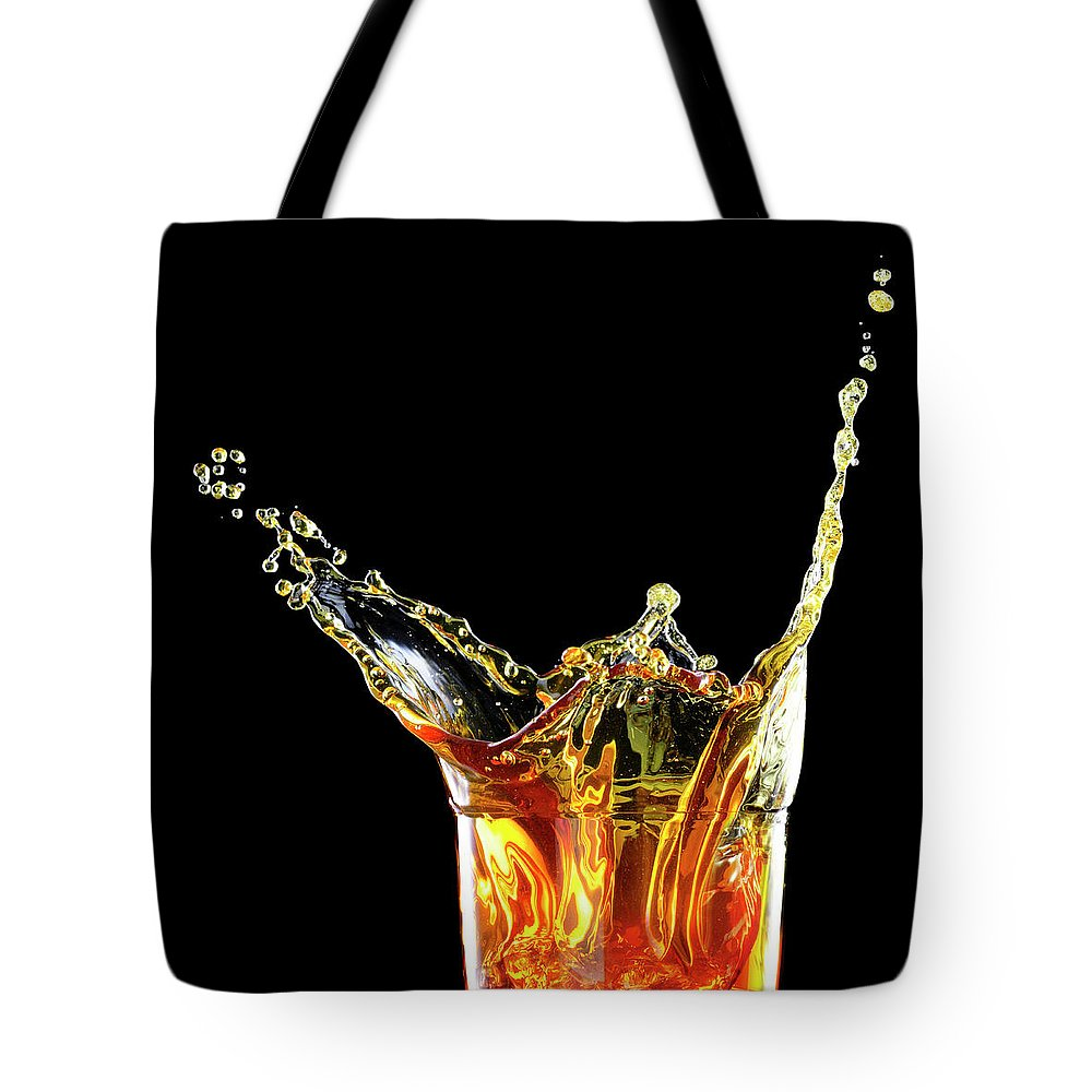 Alcohol Tote Bag featuring the photograph Cocktail With Big Splash In A Tumbler by Chris Stein