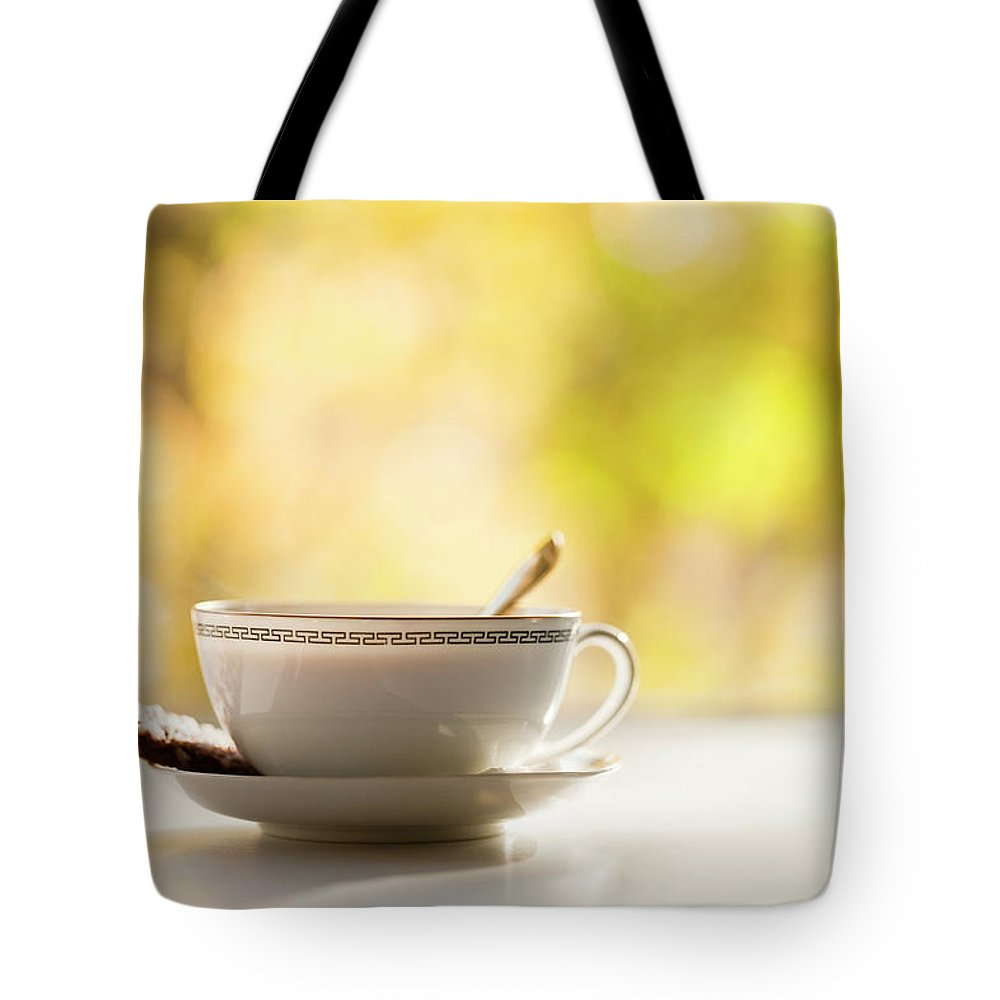 Food And Drink Tote Bag featuring the photograph Coffee Cup With Cookie, Still Life by Johner Images