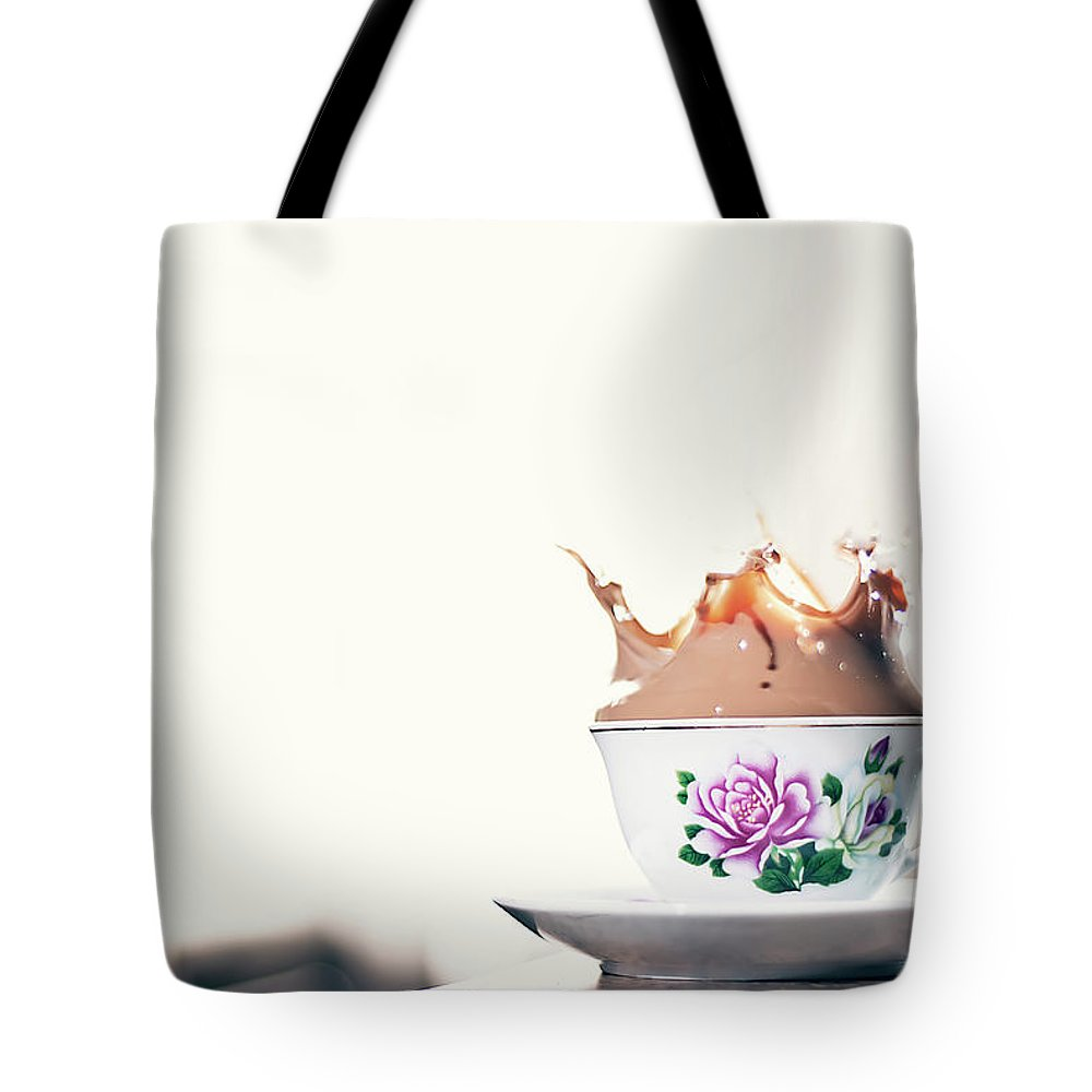 Motion Tote Bag featuring the photograph Coffee Splash In Kitchen by Photographs By Vitaliy Piltser