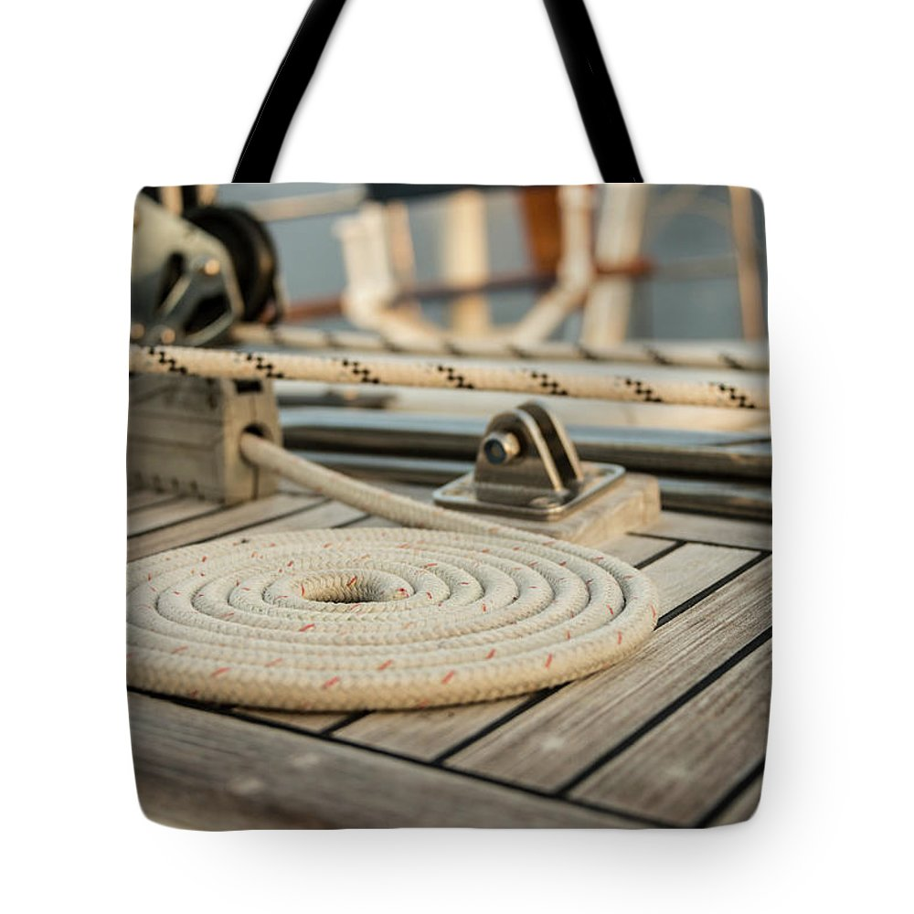 Sailboat Tote Bag featuring the photograph Coiled Line, Rope, On Teak Deck Of 62 by Gary S Chapman