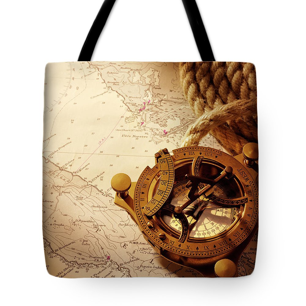 Rope Tote Bag featuring the photograph Coiled Rope And Nautical Chart With A by Wragg
