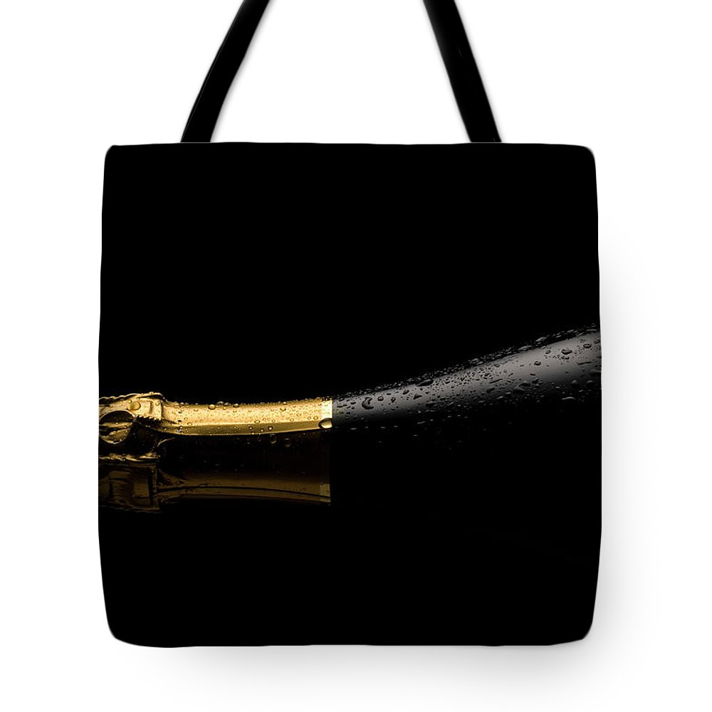 Alcohol Tote Bag featuring the photograph Cold Champagne Bottle by P1images