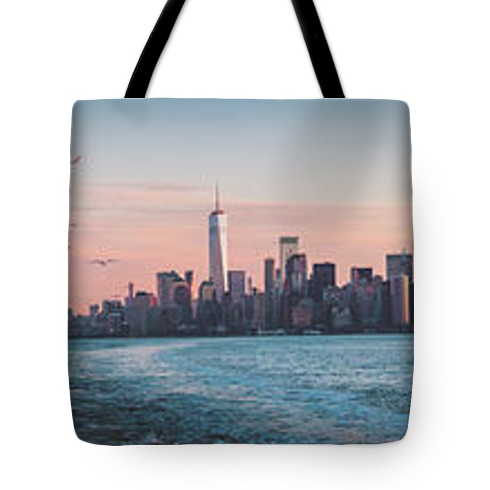America Tote Bag featuring the photograph Colorful Sunrise Over The New York Skyline And The Statue Of Lib by PorqueNo Studios