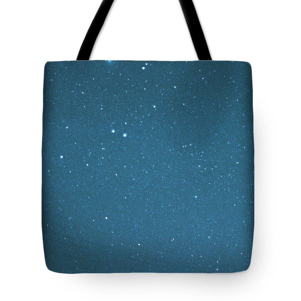 Comet Tote Bag featuring the photograph Comet Iras-araki-alcock And Star by Digital Vision.