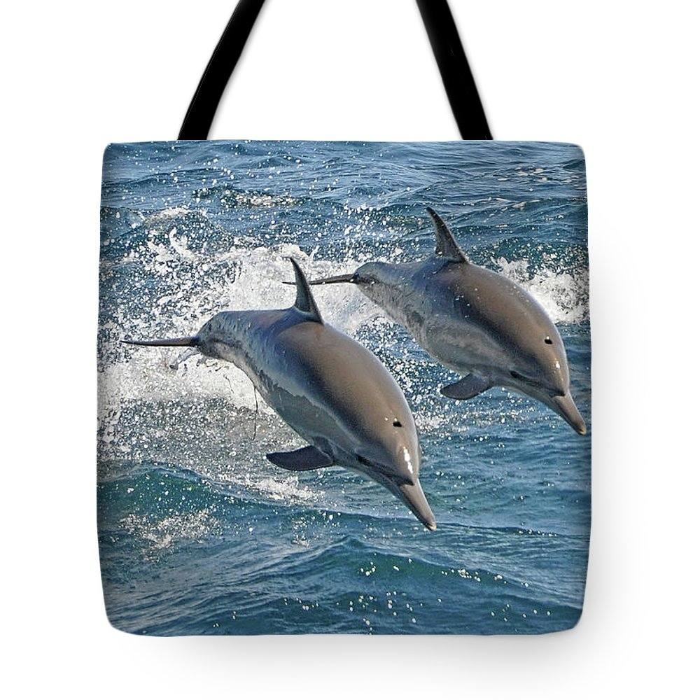 Diving Into Water Tote Bag featuring the photograph Common Dolphins Leaping by Tim Melling