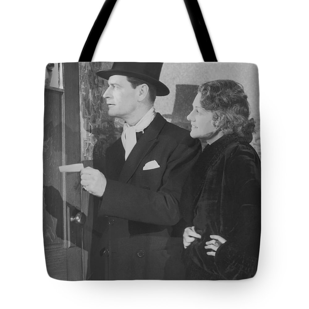 Young Men Tote Bag featuring the photograph Couple In Formal Wear Showing Pass To by Fpg