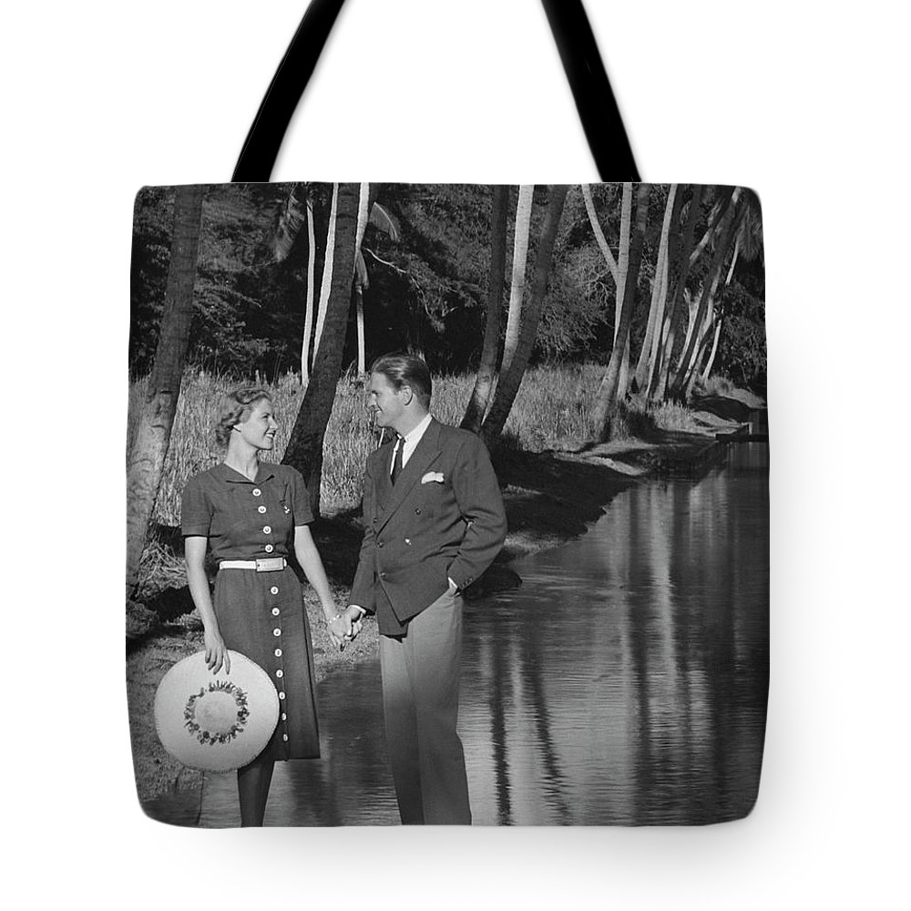 Heterosexual Couple Tote Bag featuring the photograph Couple Outdoors by George Marks