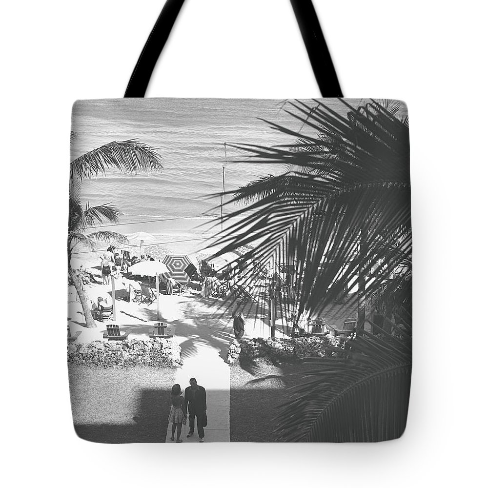 Heterosexual Couple Tote Bag featuring the photograph Couple Walking In Path Towards Beach by George Marks