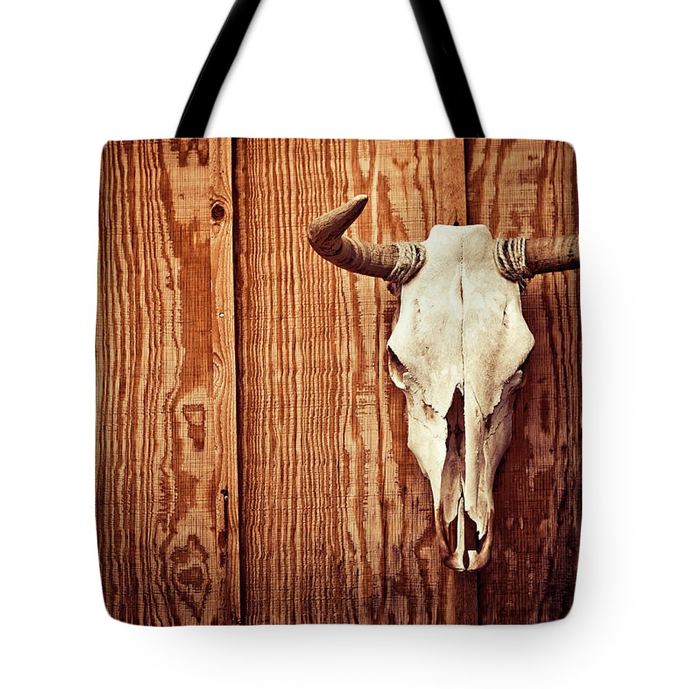 Animal Skull Tote Bag featuring the photograph Cow Skull by Thepalmer