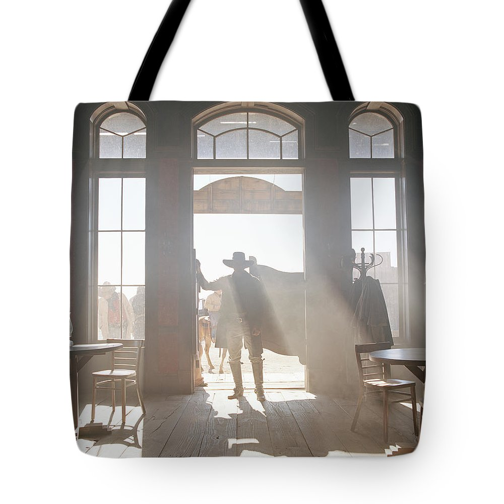 Shadow Tote Bag featuring the photograph Cowboy At Saloon by Matthias Clamer
