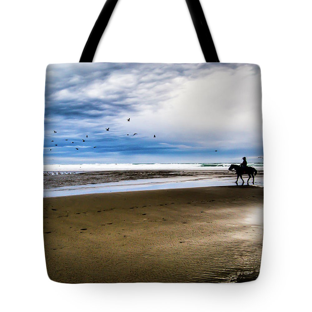 Horse Tote Bag featuring the photograph Cowboy Riding Horse On Beach by D. R. Busch