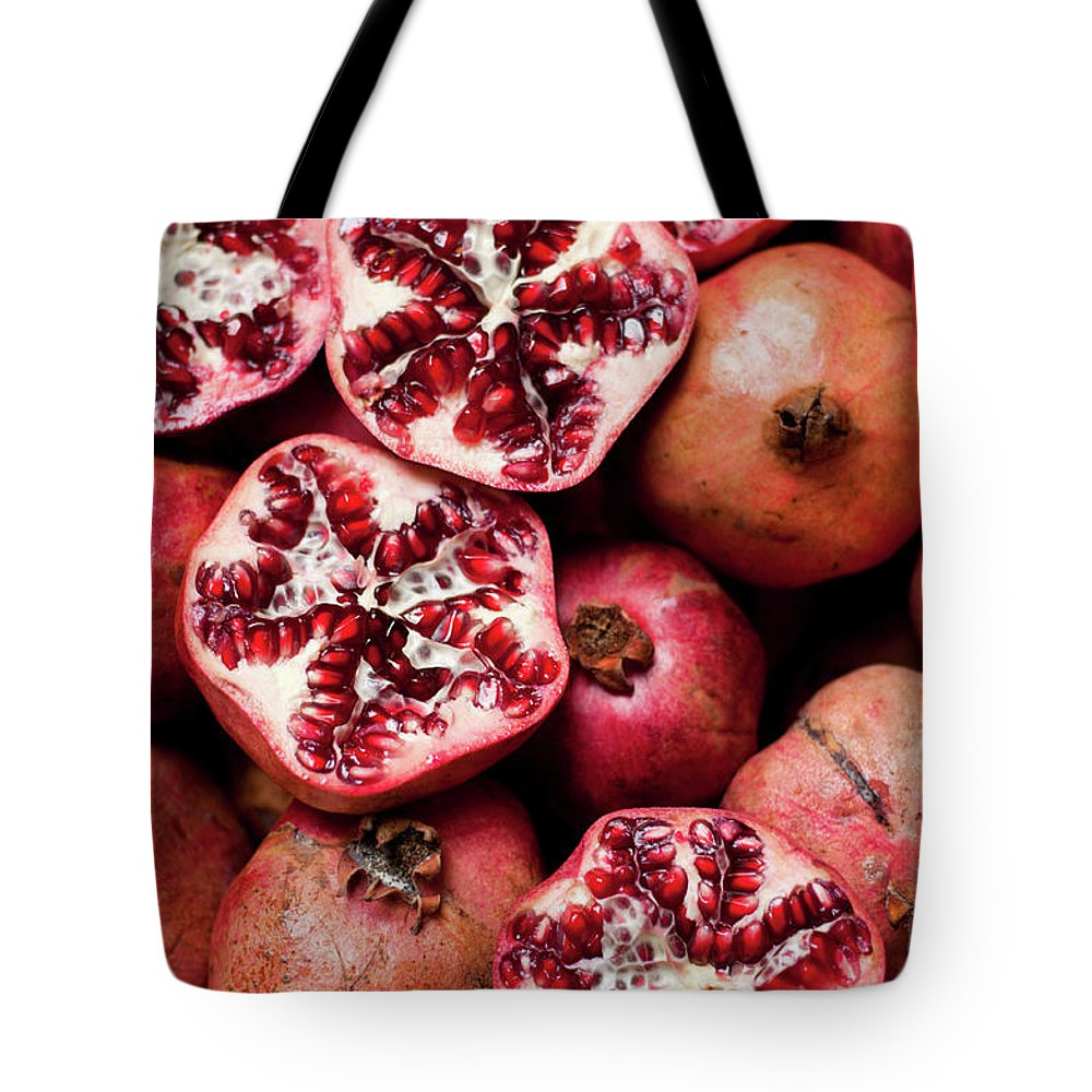 Vitamin Tote Bag featuring the photograph Cracked Pomegranate by Subman