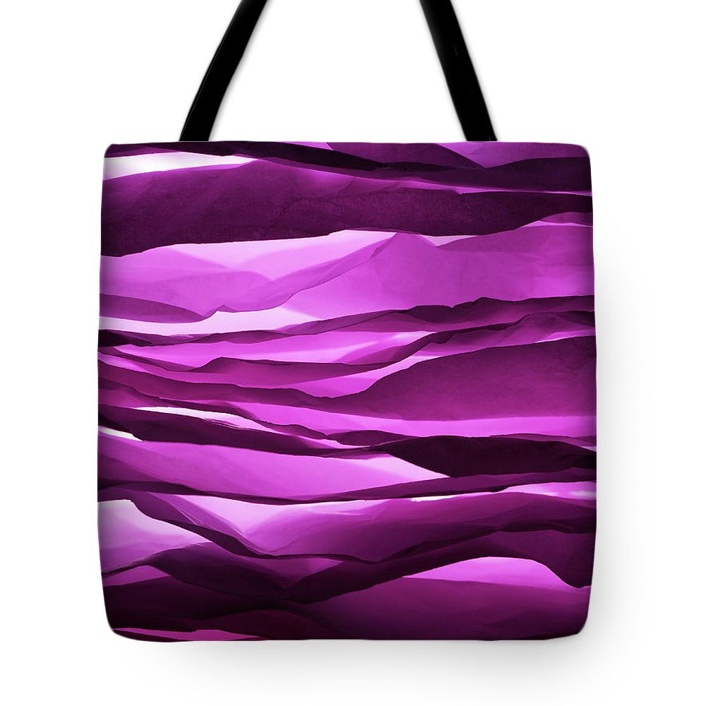 Purple Tote Bag featuring the photograph Crumpled Sheets Of Purple Paper by Ballyscanlon